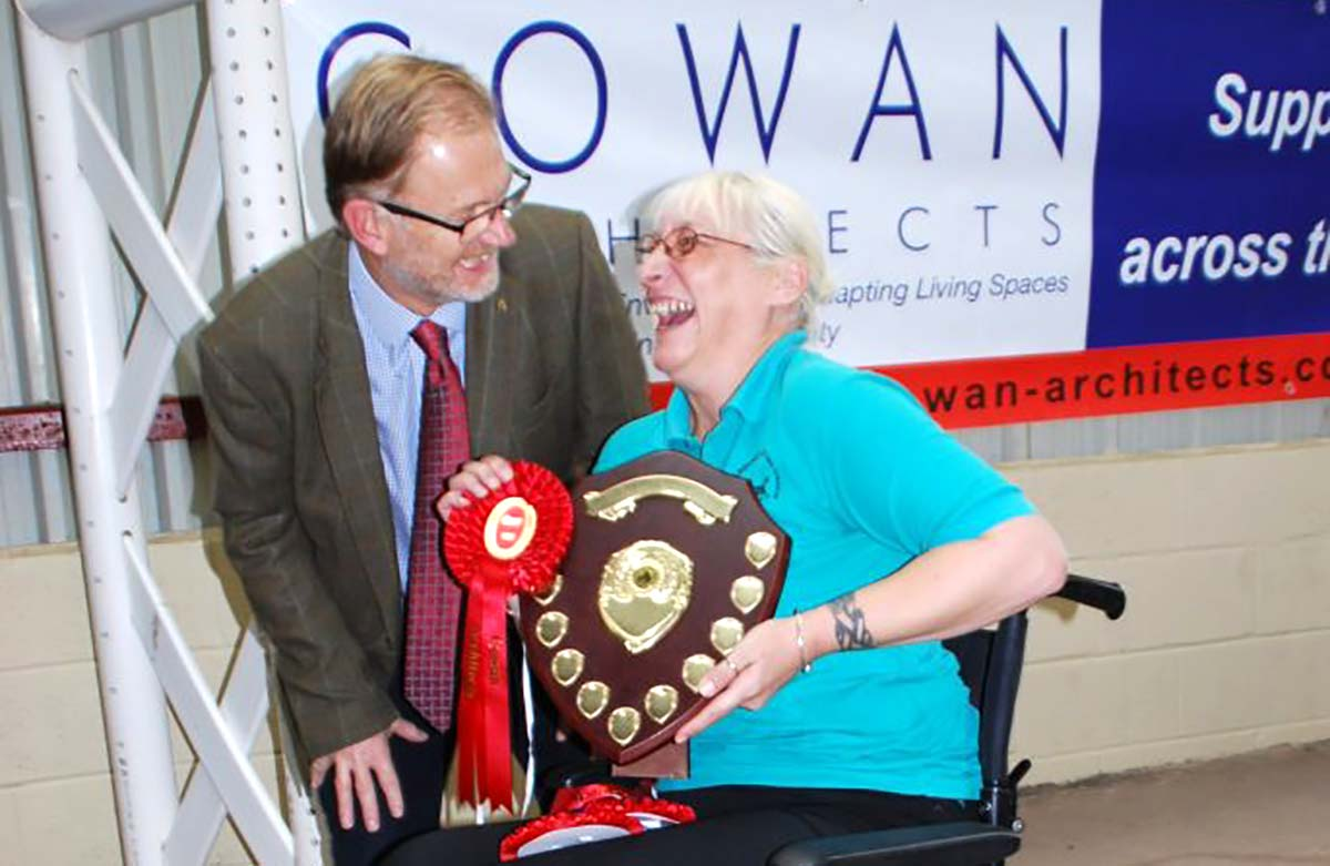 Phillip Mumford MD of sponsors Cowan Architects shares a laugh with Amanda Hardy who won the Intermediate Whip-class