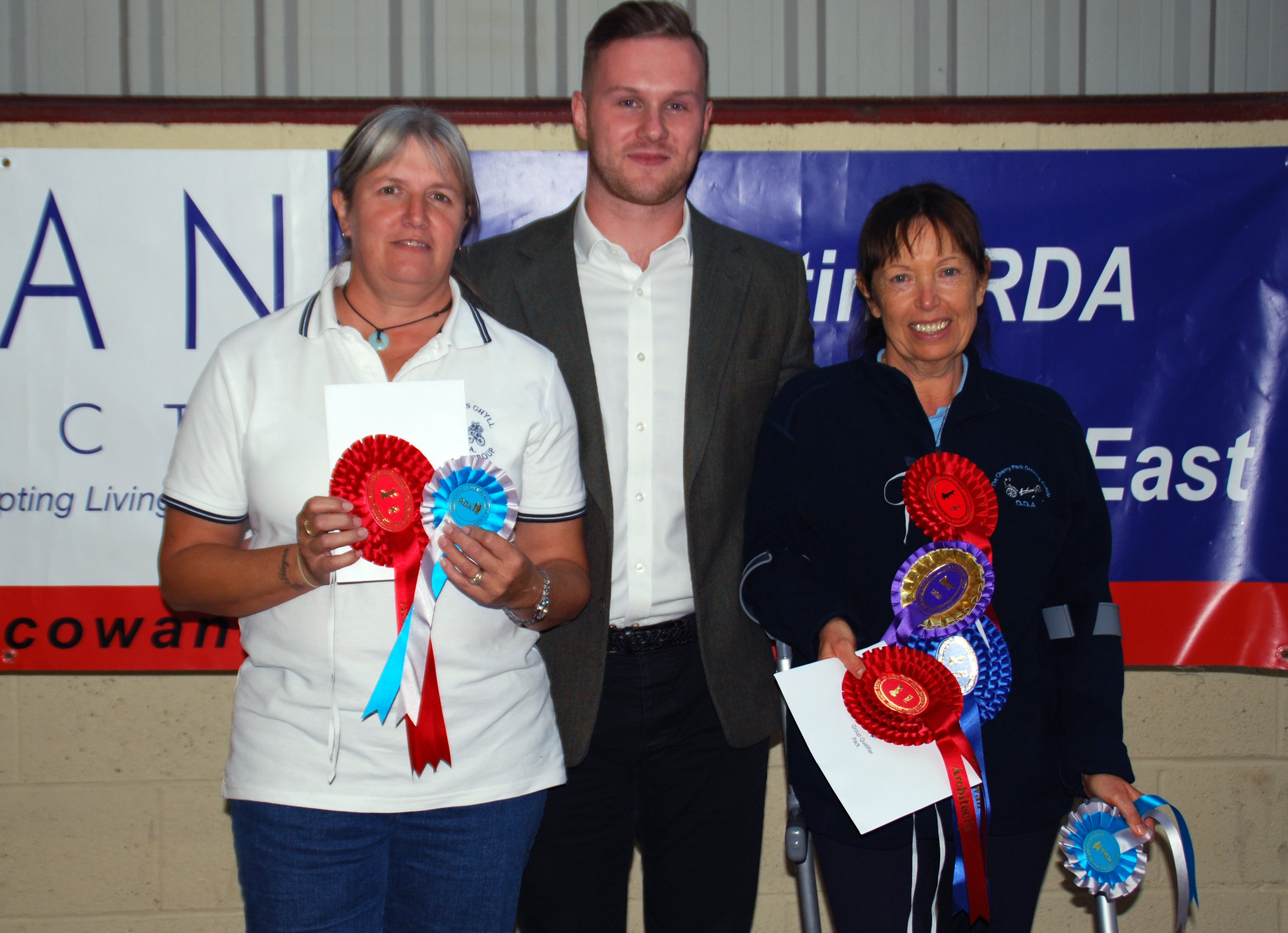 xQualifiers winning equal 1st place overall Vianne Carr of Heron's Ghyll (left) with Sandra Spinner of Cherry Park (right) and Aaron Dellaway of sponsors Cowan Architects