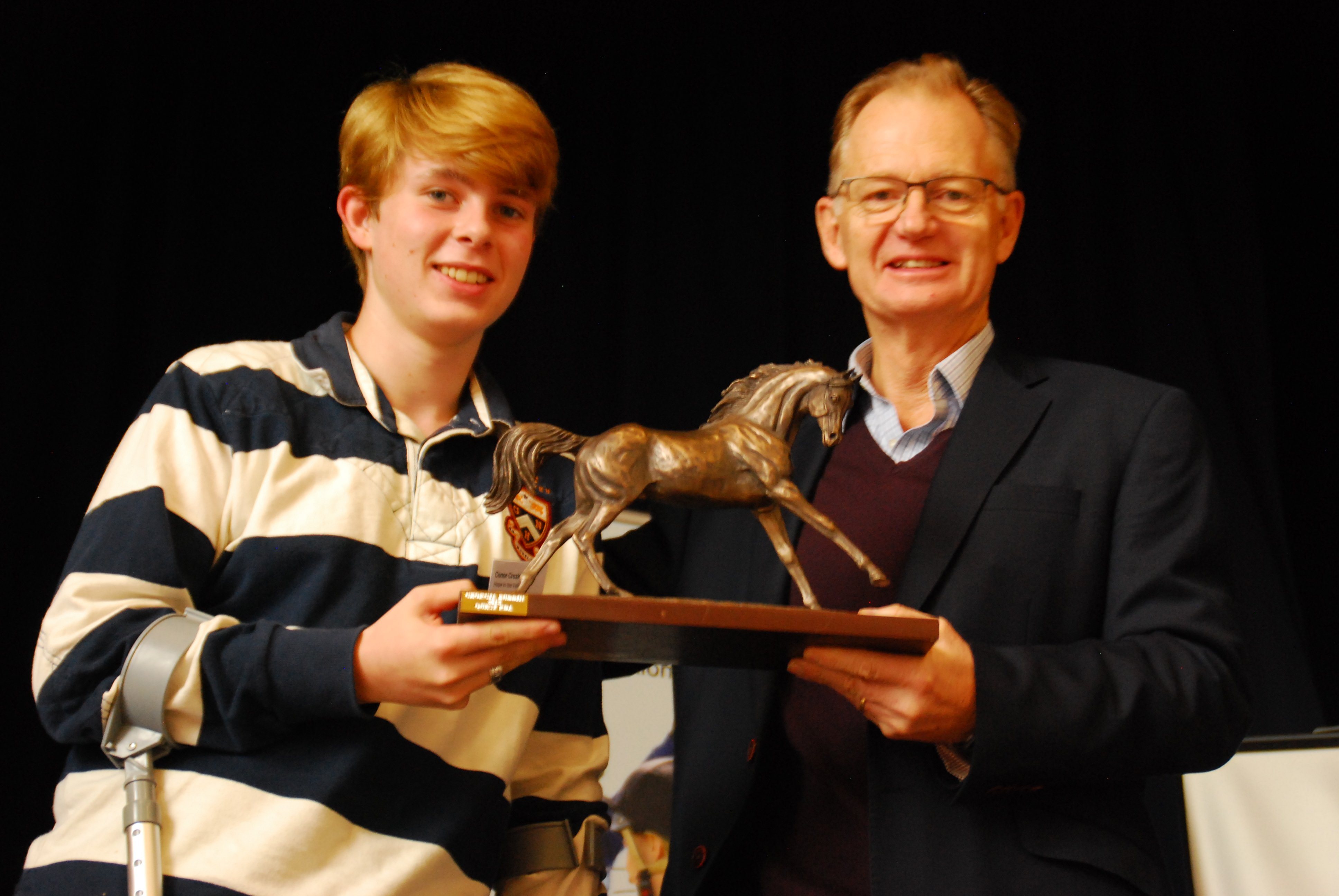 Photo showing Phillip Mumford presenting the Cowan Trophy to Conor Crozier as the RDA's 2019 Young Volunteer of the Year