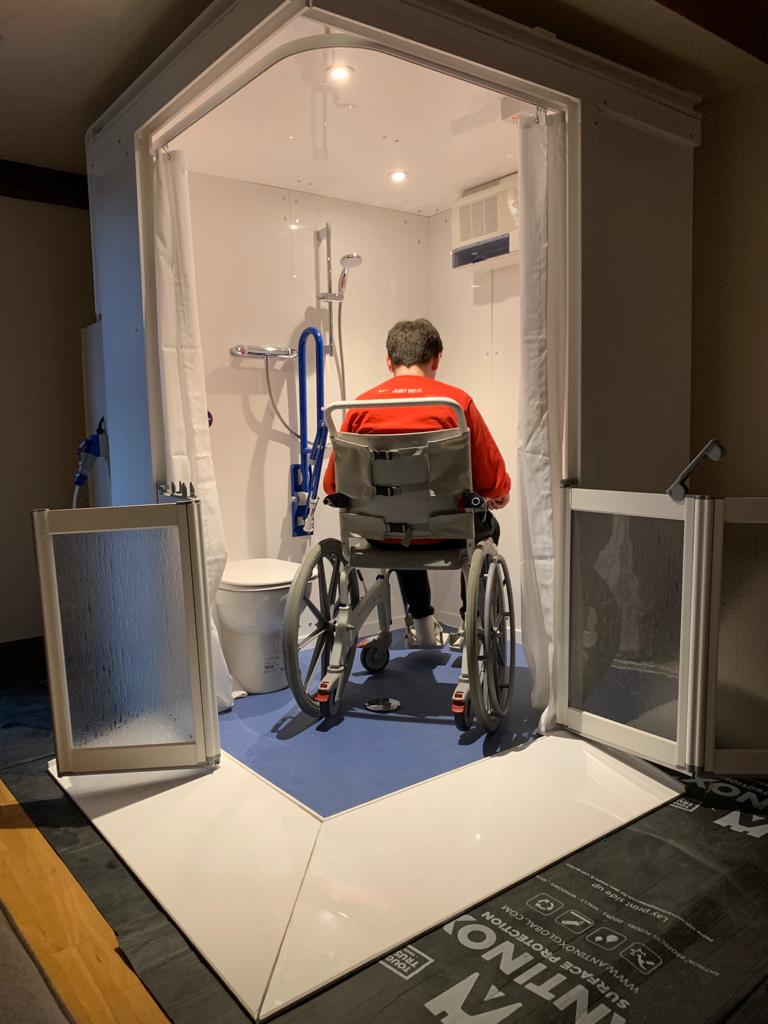 Photo showing Micro WashPod with Wheelchair user